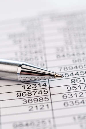 examiner: a table with the figures of revenue and expenditure. photo icon for kosetn, profit, controlling