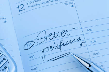 tax consultants: an appointment is entered on a calendar: tax audit Stock Photo