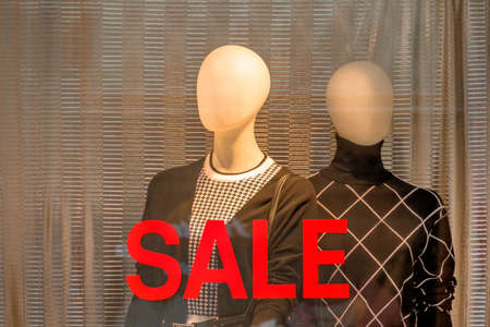 sale shop: seasonal sale in a fashion shop. time for bargain hunters Stock Photo
