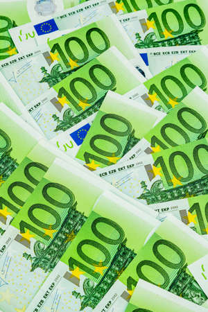 adjacent: many einhhundert euro banknotes are adjacent. photo icon for wealth and investment