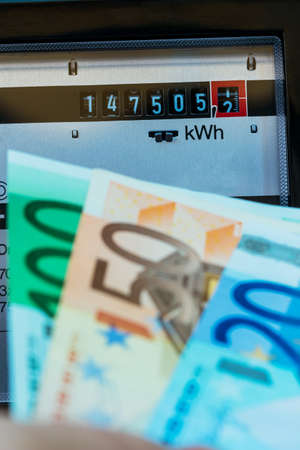 electricity meter: ein electricity meter measures the current consumed. save icon photo for electricity price and electricity