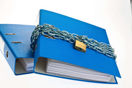 insider information: a filing with chain and padlock closed. data protection and data safety. Stock Photo