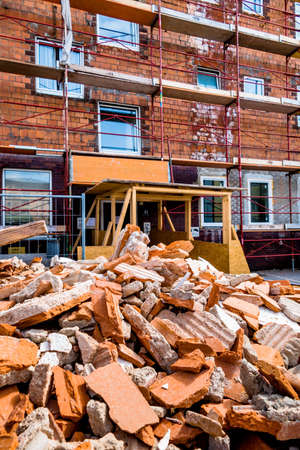 immobilien: rubble at a construction site during renovation work in a container. house is being renovated. Stock Photo