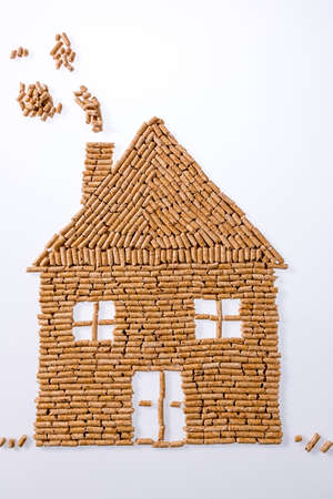 sustained: a house was built of pellets for heating. alternative and sustainable energy for heating Stock Photo