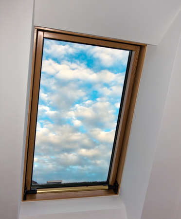 roof apartment: sky, clouds, roof window, roof apartment with view into the clouds Stock Photo