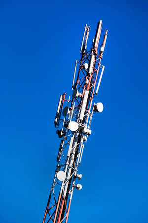 mobilfunkmast and blue sky, a symbol of communication, mobility, radio communications Banco de Imagens