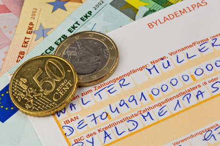 seemingly: a payment slip for transfer with iban number and bic code in germany. Stock Photo