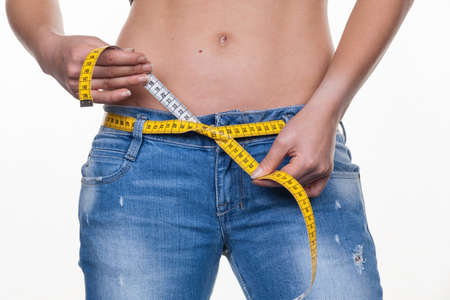 where to eat: a young woman with a tape measure before the next diet. dieting and fasting Stock Photo