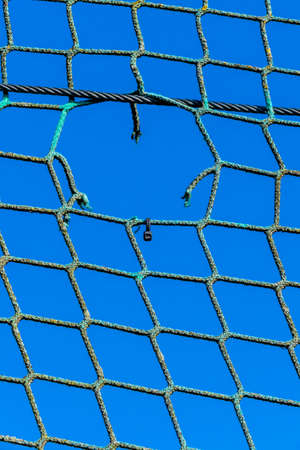 deficient: hole in a net, symbolizing captivity obstacle hope damage