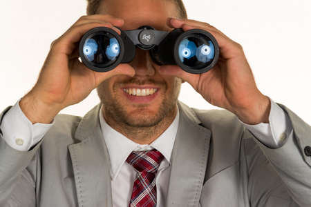 young entrepreneurs: a manager (young entrepreneurs) with binoculars looking for contracts or jobs Stock Photo