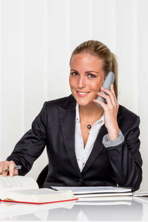 proceeding: businesswoman sitting in an office. photo icon for managers, self-employment or lawyer.