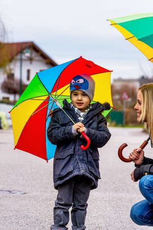 skepticism: child with umbrella, a symbol of childhood, solidarity, assistance, bailout, bailout,