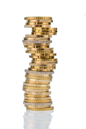savers: stack money coins against white background, symbol photo for saving, thrift, small savers