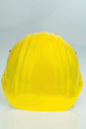collective bargaining: yellow industrial safety helmet, symbol photo for labor, occupational safety and accident prevention