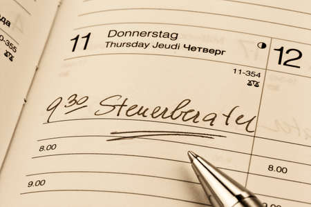 tax consultants: an appointment is entered on a calendar: tax consultants Stock Photo