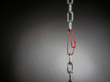 spirit: a chain is held together with a b?rokklammer. symbol photo for security, trust and teamwork Stock Photo