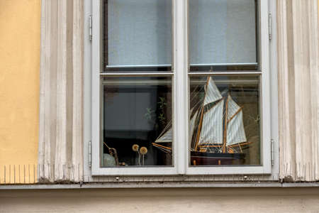 wistfulness: ship model on the windowsill, symbol for traveling, sailing, wanderlust Stock Photo