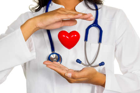 supplementary: a young doctor (internist) holding a heart symbolically in hand. Stock Photo