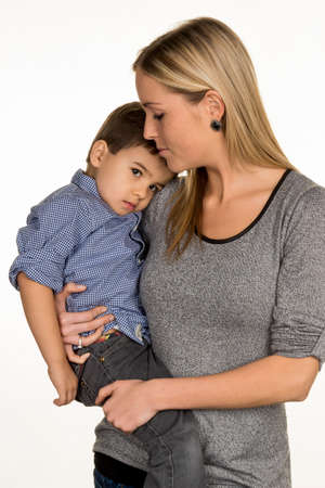 solicitous: mother and son, symbol of love, care, single mother Stock Photo