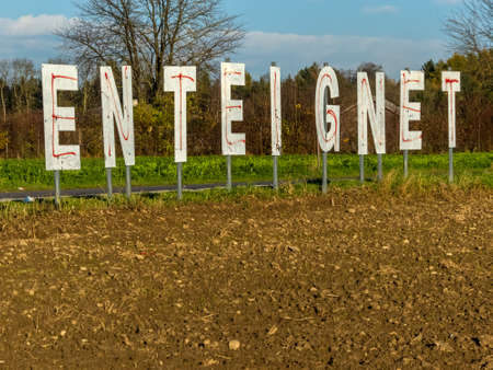 erected: a farmer has the word expropriates erected in his field.