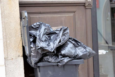 household waste: bin or trash bin for household waste in front of a residential building Stock Photo