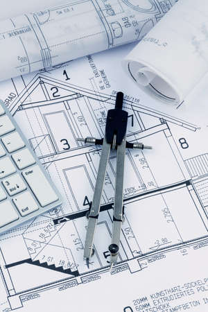 immobilien: an architects blueprint for the construction of a new residential building. symbol photo for funding and planning of a new house.
