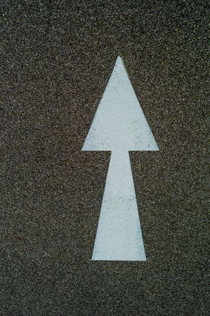 marking up: arrow as directional marker on a bike path in linz, austria