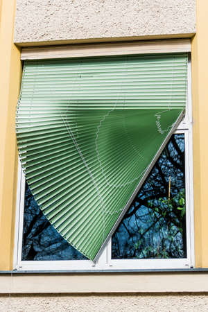 lamellar: broken blinds on a window at a school in linz, austria