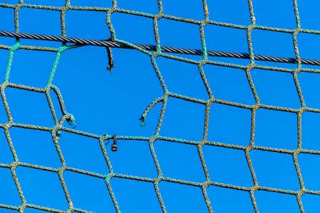 incarcerated: hole in a net, symbolizing captivity obstacle hope damage