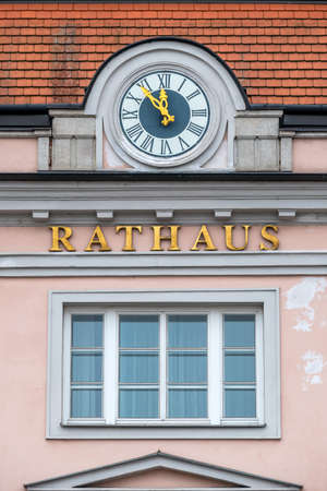 budgetary: clock on the facade, symbol of an empty treasury in municipalities and communities. 5vor12 for municipal budget Stock Photo