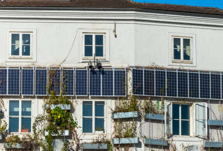 panel: solar panels for use of solar energy on a residential building. alternative energy for townhouses. Stock Photo