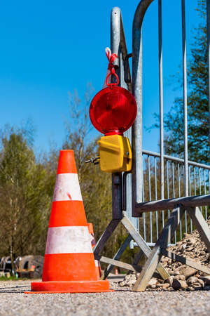 safeguarding: road construction site. asphalt will be renewed. hedge the construction site on a road. Stock Photo