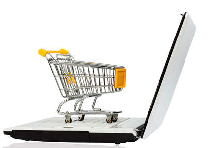 consumerist: an empty shopping cart on a laptop computer. symbol photo for shopping on the internet
