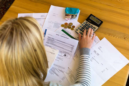 indebted: a woman with unpaid bills has many debts. unemployment and personal bankruptcy Stock Photo