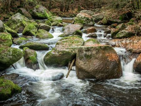 fluent: a creek with rocks and running water. landscape experience in nature.
