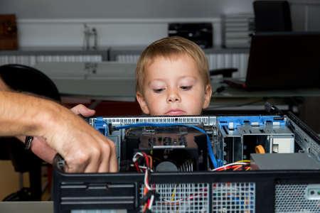 hard drive crash: a man repairs a computer in an office