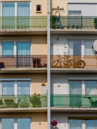 immobilien: many balconies in a house for several parties in a city. Stock Photo