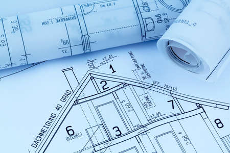 immobilien: a blueprint of an architect for the construction eiones new house. symbolic photo for financing and planning of a new house.