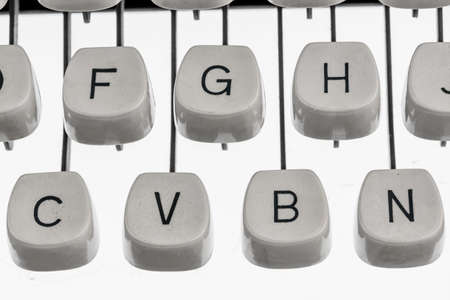 illiteracy: keyboard and letters of an old typewriter. symbol photo for communication in earlier times