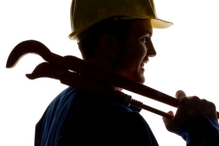 socially: a worker in a business enterprise (craftsmen) with tools in hand