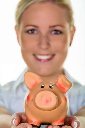 peoplesoft: a young woman holding a piggy bank in hand