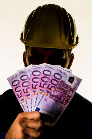 botch: a worker in a commercial operation with banknotes in his hand