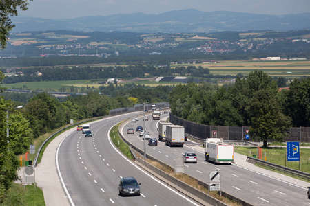 pkw: many cars on a three-lane motorway. symbol photo on transport and tourism