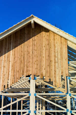subsidy: wooden roof construction, symbol photo for home, home construction, and home financing