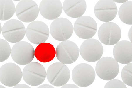 outsider: white tablets in contrast with a red tablet, symbol photo for bullying and individuality