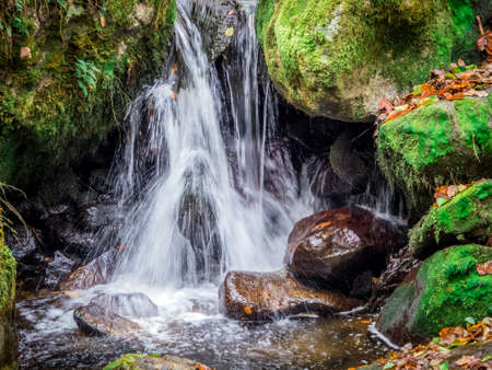 hydroelectricity: a creek with rocks and running water. landscape experience in nature.