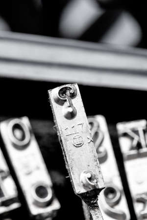 contentious: question marks on an antique typewriter. symbol photo for questions and answers