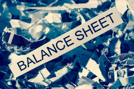 papierschnitzel tagged balance sheet, symbol photo for data destruction, balance sheets and accounting Stock Photo