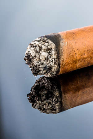 investigated: smoking cigar. an icon photo for addiction and related