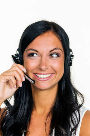 os: a young woman in an mcc telephoned customers with a headset Stock Photo